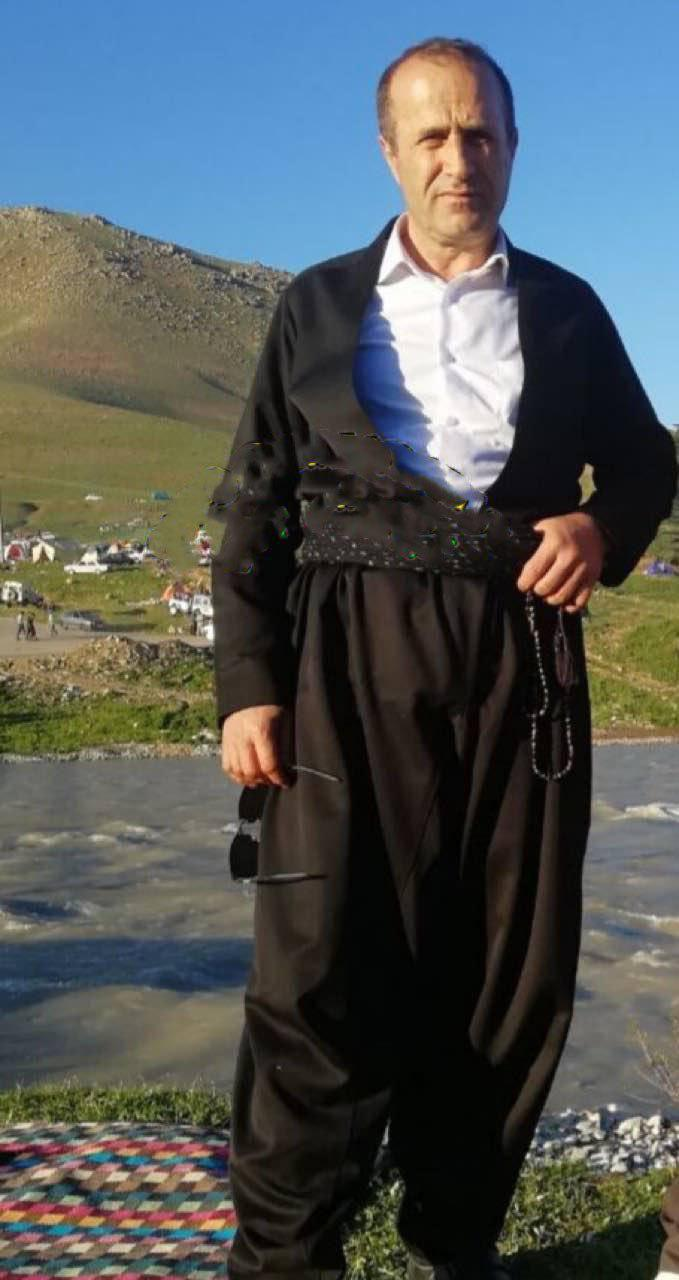 kolbar_iranian_kurds_taking_loads_on_backs.jpg